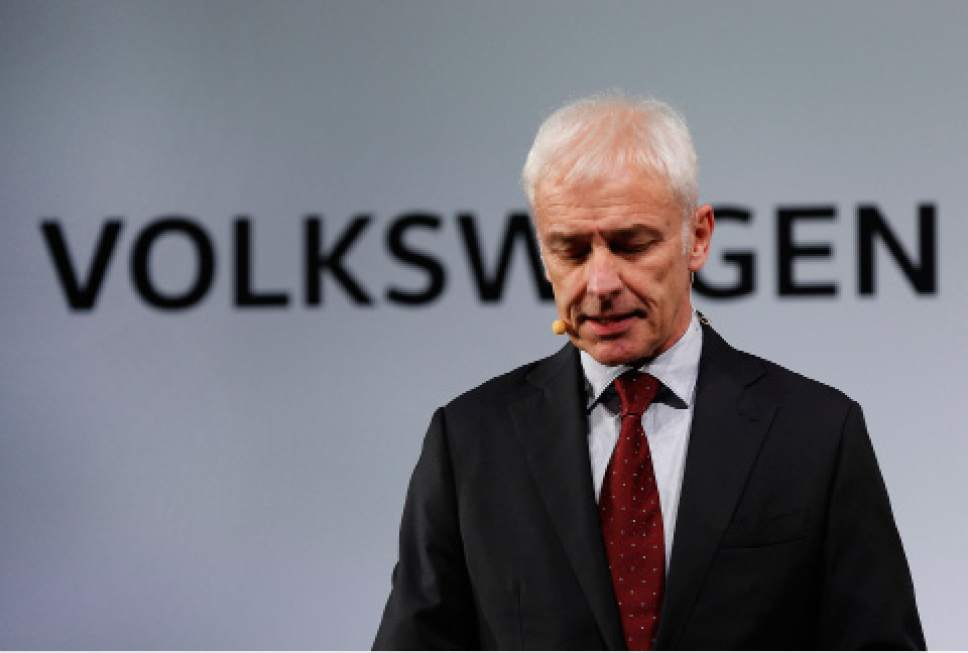 FILE - In this Jan. 10, 2016, file photo, Volkswagen AG chief executive officer Matthias Muller speaks in Detroit. Volkswagen is facing a deadline of Monday, Dec. 19, 2016, to tell a federal judge in San Francisco whether it has reached a deal with U.S. regulators and attorneys for car owners on the remaining 80,000 diesel vehicles that cheated on emissions tests (AP Photo/Paul Sancya, File)