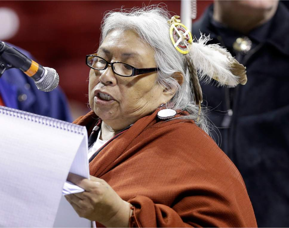 "FILE- In this April 18, 2013, file photo, Faith Spotted Eagle speaks in opposition to the Keystone XL pipeline, during the U.S. State Department's sole public hearing in Grand Island, Neb. The South Dakota activist says she is ""totally shocked"" that she got a vote for president from the Electoral College this week. Sixty-eight-year-old Faith Spotted Eagle of Lake Andes received one vote Monday, Dec. 19, 2016, from an elector in Washington state. (AP Photo/Nati Harnik, File)"