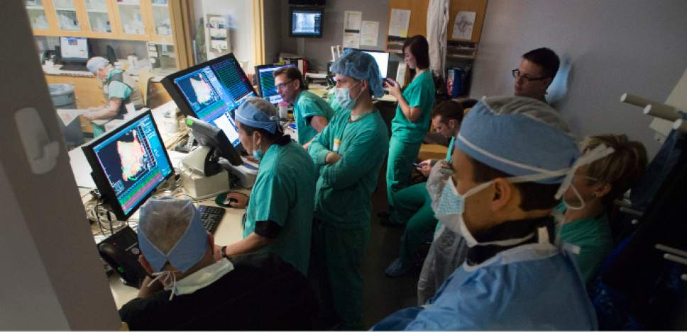 Steve Griffin / The Salt Lake Tribune   Medical staff watches as Intermountain Medical Center Heart Institute electrophysiologist John Day, MD, left, performs the nation's first case using new heart-mapping technology for the treatment of abnormal heart rhythms at the Intermountain Medical Center Heart Institute in in Murray Monday December 19, 2016.  During the procedure, the Intermountain Medical Center team, used St. Jude Medical's EnSite PrecisionTM cardiac mapping system to create 3-D images of the heart.
