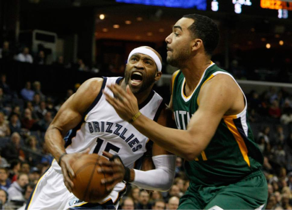 Memphis Grizzlies Vince Carter (15) takes a shot while being defended by Utah Jazz' Trey Lyles (41) in the first half of an NBA basketball game Sunday, Dec. 18, 2016, in Memphis, Tenn. (AP Photo/Karen Pulfer Focht)