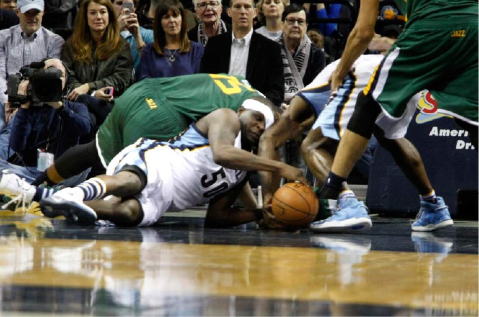 Memphis Grizzlies' Zach Randolph (50) fights for a loose ball in the second half of an NBA basketball game against the Utah Jazz, Sunday, Dec. 18, 2016, in Memphis, Tenn. (AP Photo/Karen Pulfer Focht)