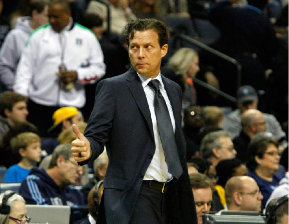 Utah Jazz head coach Quin Snyder signals to his players in the first half of an NBA basketball game against the Memphis Grizzlies, Sunday, Dec. 18, 2016, in Memphis, Tenn. (AP Photo/Karen Pulfer Focht)
