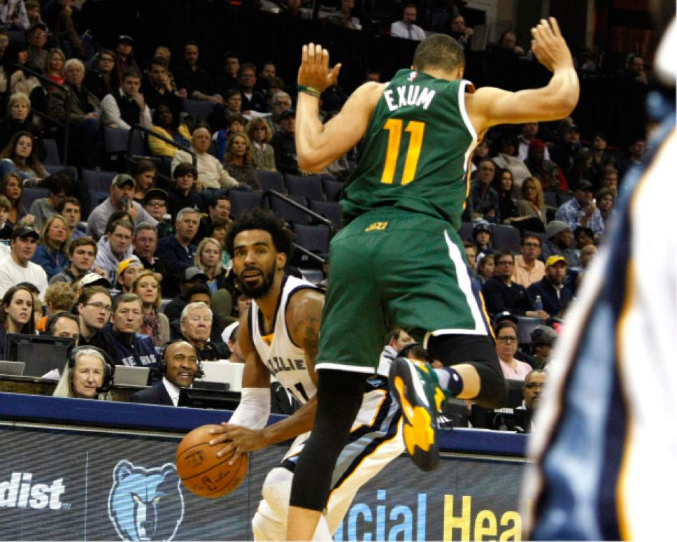 Utah Jazz' Dante Exum (11) tried to block a shot by Memphis Grizzlies' Mike Conley (11) in the first half of an NBA basketball game Sunday, Dec. 18, 2016, in Memphis, Tenn. (AP Photo/Karen Pulfer Focht)