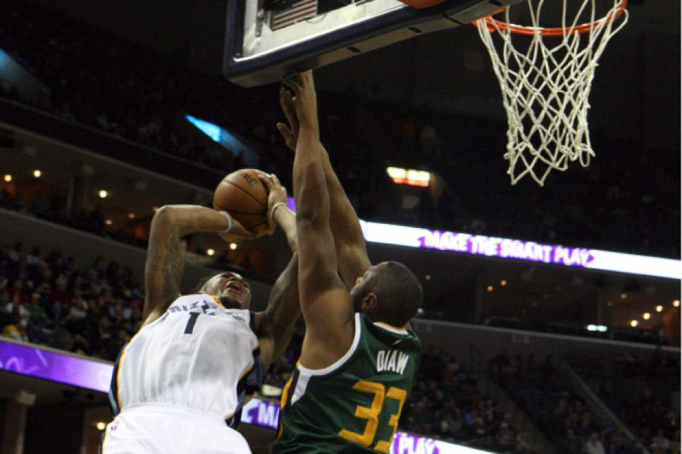 Memphis Grizzlies' Jarell Martin (1) is fouled by Utah Jazz' Boris Diaw (33) in the first half of an NBA basketball game Sunday, Dec. 18, 2016, in Memphis, Tenn. (AP Photo/Karen Pulfer Focht)
