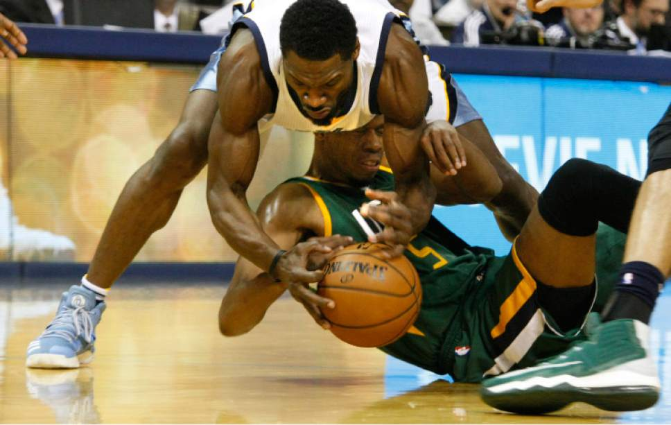 Memphis Grizzlies' Tony Allen (9) and Utah Jazz' Rodney Hood (5) fight for a loose ball in the first half of an NBA basketball game Sunday, Dec. 18, 2016, in Memphis, Tenn. (AP Photo/Karen Pulfer Focht)