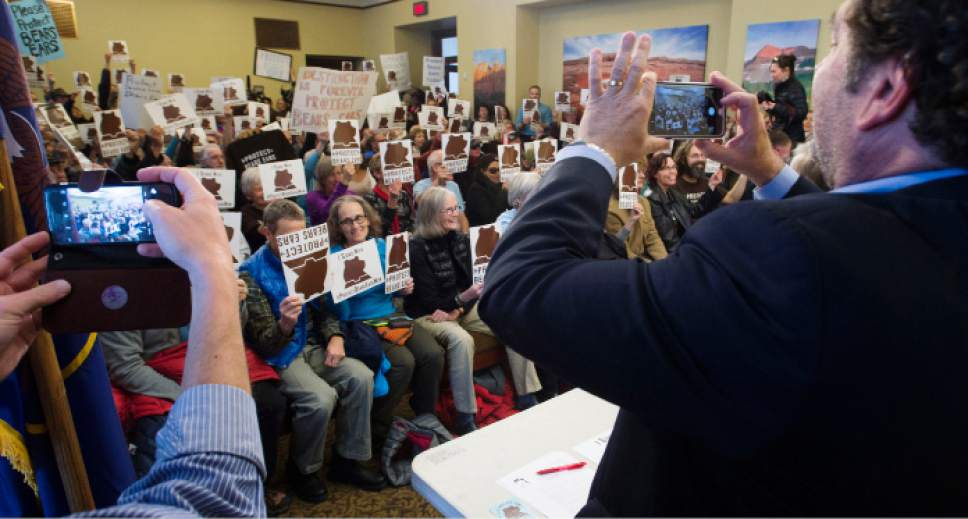 Steve Griffin / The Salt Lake Tribune   Pro- Bears Ears National Monument supporters hold up their Bears Ears signs during press conference at the Utah State Capitol Preservation Room in Salt Lake City Monday December 19, 2016.  Speakers included Chairman Shaun Chapoose, Ute Indian Tribe of the Uinta Ouray Reservation, Delegate Davis Filfred, Navajo Nation Council and Malcolm Lehi, former White Mesa representative of the Ute Mountain Ute Tribal Council.