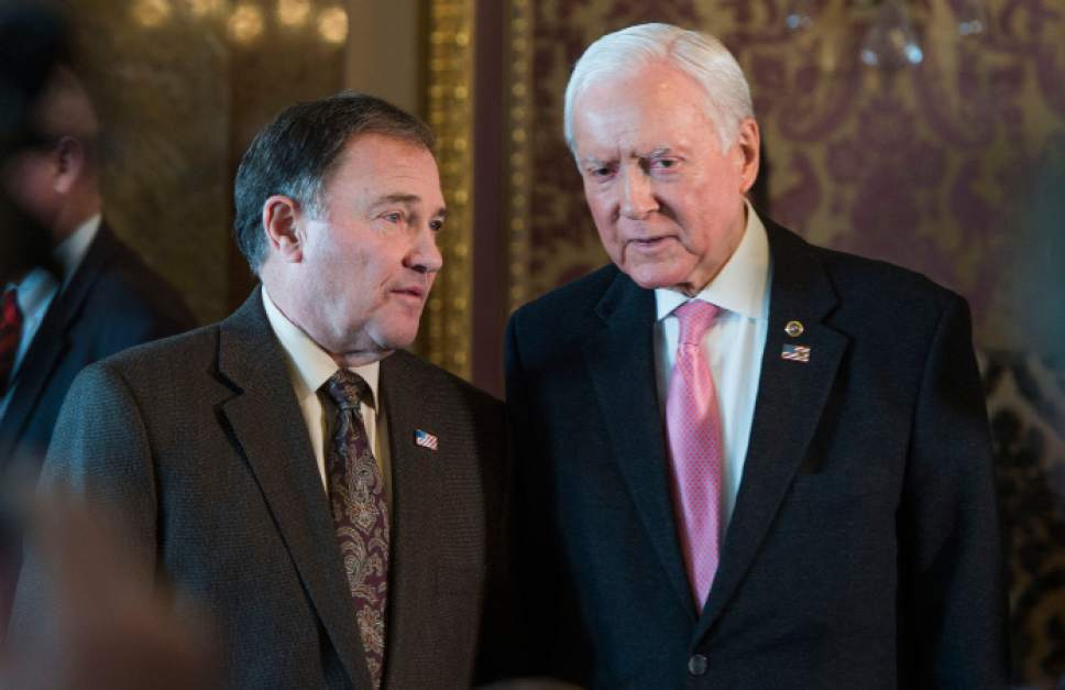 Steve Griffin / The Salt Lake Tribune   Gov. Gary Herbert and Sen. Orrin Hatch talk before the start of a press conference in the Gold Room at the Utah State Capitol as 17 elected leaders of Utah gathered to  urge President Obama to not designate Bears Ears as a national monument in Salt Lake City Monday December 19, 2016.