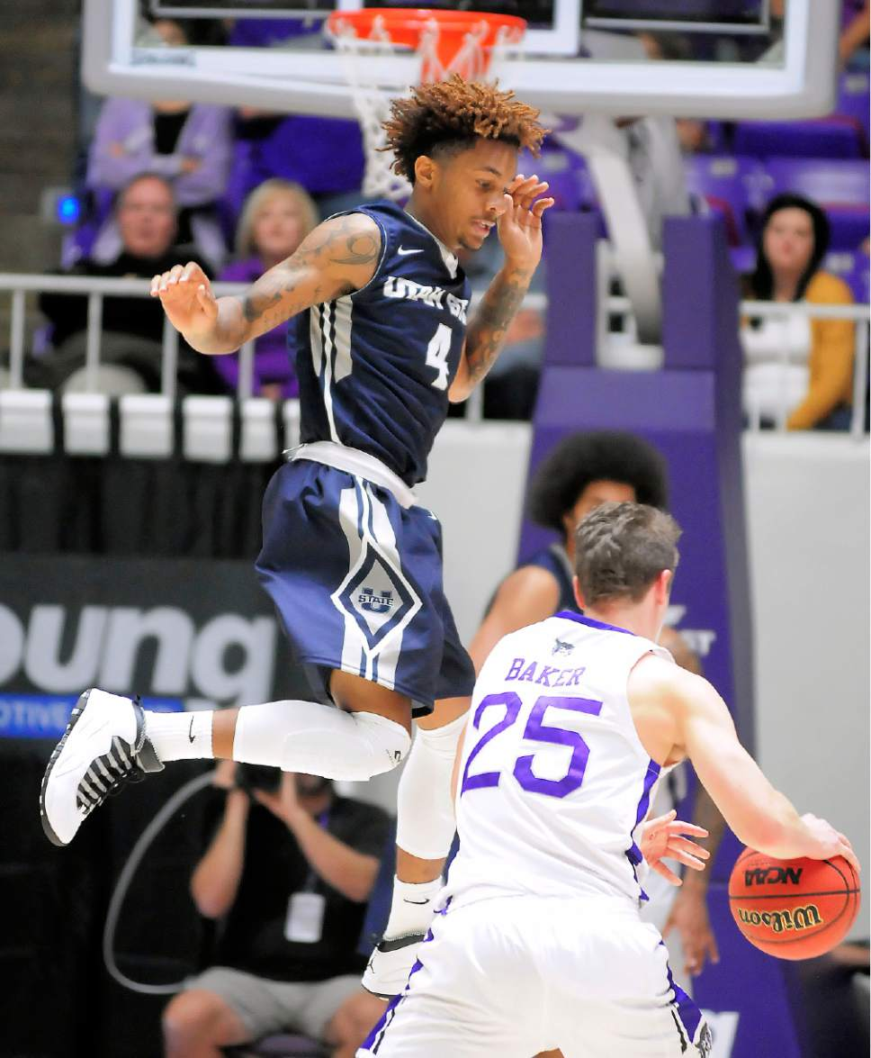 college basketball: neighboring utah state, weber state continue 102