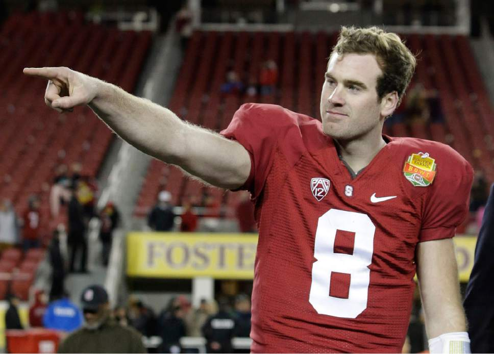 FILE - In this Tuesday, Dec. 30, 2014, file photo, Stanford quarterback Kevin Hogan points to his teammates as he is named offensive MVP after a 45-21 win over Maryland during the Foster Farms Bowl NCAA college football game in Santa Clara, Calif. After a down season a year ago, Stanford hopes to get back to the top of the Pac-12.(AP Photo/Marcio Jose Sanchez, File)
