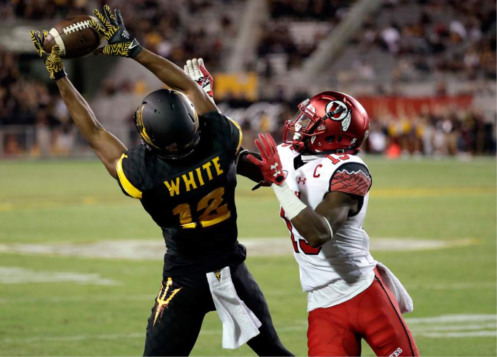 Arizona State wide receiver Tim White (12) scores a touchdown as Utah defensive back Dominique Hatfield (15) defends during the second half of an NCAA college football game, Thursday, Nov. 10, 2016, in Tempe, Ariz. (AP Photo/Matt York)
