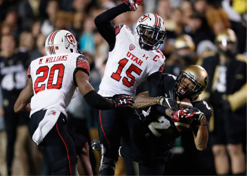 Colorado wide receiver Devin Ross, right, loses control of the ball as he tries to catch a pass in front of Utah defensive backs Dominique Hatfield, center, and Marcus Williams in the second half of an NCAA college football game Saturday, Nov. 26, 2016, in Boulder, Colo. Colorado won 27-22. (AP Photo/David Zalubowski)