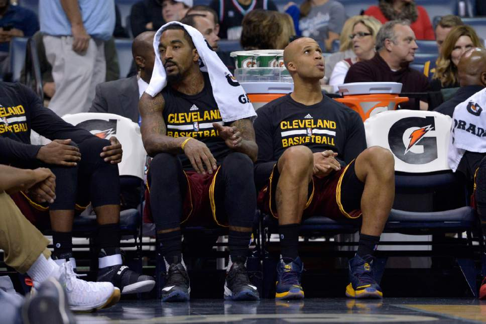 FILE - In this Dec. 14, 2016, file photo, Cleveland Cavaliers guard J.R. Smith, left, and forward Richard Jefferson (24) sit next to empty chairs on the bench in the second half of an NBA basketball game against the Memphis Grizzlies, in Memphis, Tenn. J.R. Smith needs surgery on his right thumb and will be sidelined indefinitely. Smith got hurt late in the first half of Tuesday night's, Dec. 20, 2016, game in Milwaukee. (AP Photo/Brandon Dill, File)