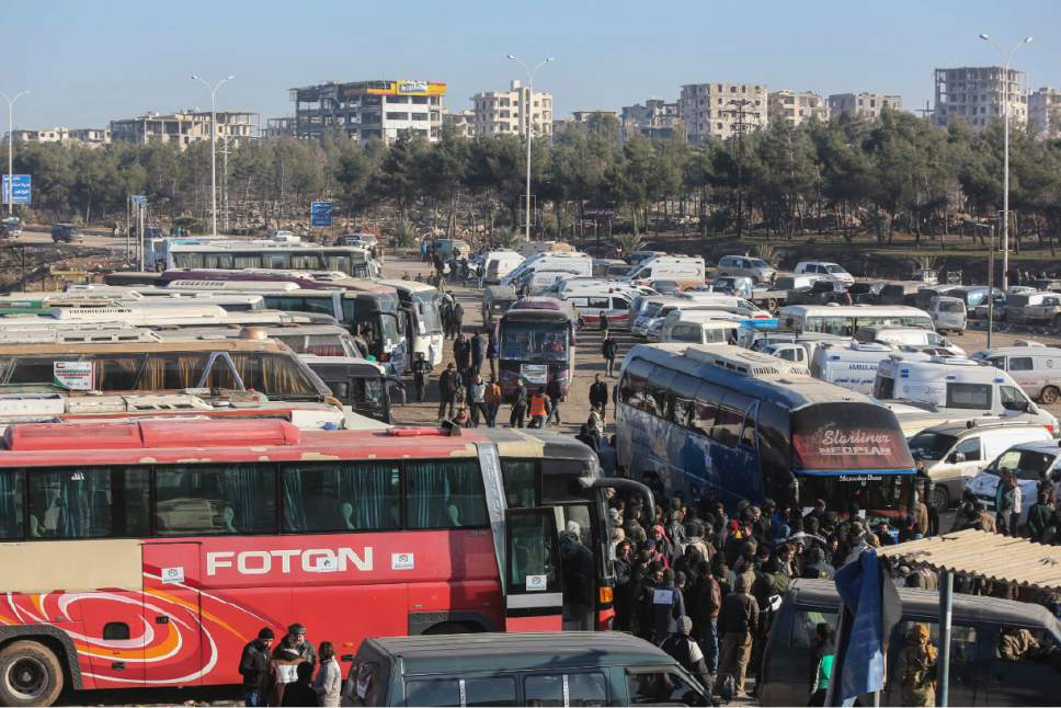 Syrians evacuated from the embattled Syrian city of Aleppo during the ceasefire arrive at a refugee camp in Rashidin, near Idlib, Syria, Tuesday, Dec. 20, 2016. Russian Foreign Minister Sergey Lavrov said on Tuesday that Russia, Iran and Turkey are ready to act as guarantors in a peace deal between the Syrian government and the opposition. He spoke on Tuesday after a meeting of the three countries' foreign ministers in Moscow. (AP Photo)