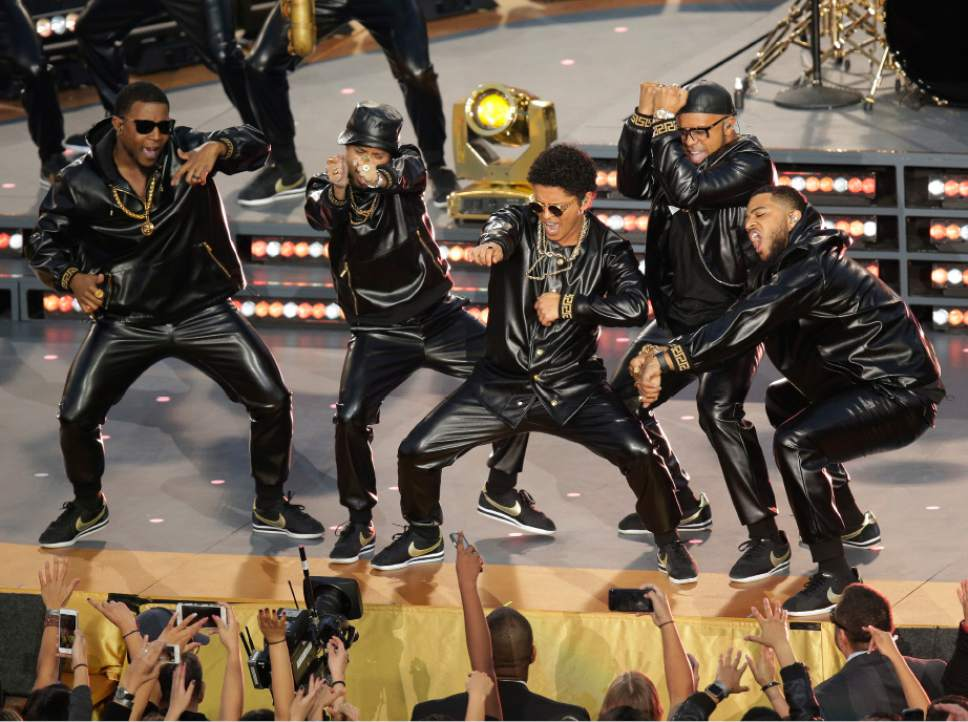 "FILE - In this Feb. 7, 2016 file photo, Bruno Mars performs ""Uptown Funk"" during halftime of the NFL Super Bowl 50 football game in Santa Clara, Calif. The song is nominated for a Grammy for record of the year.  (AP Photo/Charlie Riedel, File)"