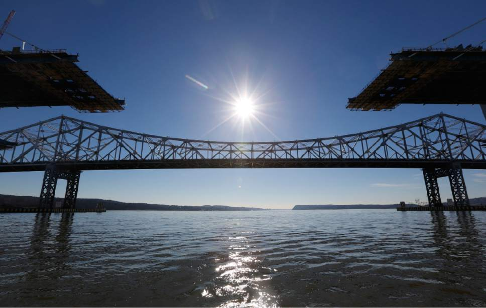 A span on the new Tappan Zee Bridge, foreground, awaits completion while motorists continue to use the older bridge, background, near Tarrytown, N.Y., Tuesday, Dec. 20, 2016. The $4 billion bridge replacement, one of the biggest infrastructure efforts currently underway in the U.S. (AP Photo/Seth Wenig)