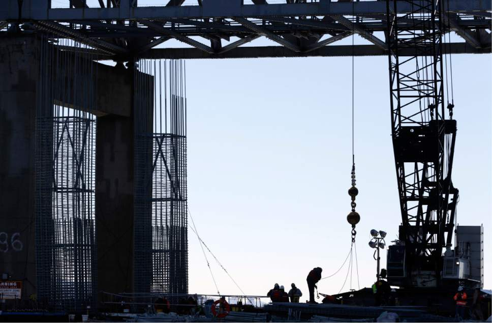 Work continues on the new Tappan Zee Bridge near Tarrytown, N.Y., Tuesday, Dec. 20, 2016. The concrete needed for New York's new, $4 billion Tappan Zee Bridge, under construction over the Hudson River, would be enough to make a 1,500-mile sidewalk reaching all the way to Florida's Key West. (AP Photo/Seth Wenig)