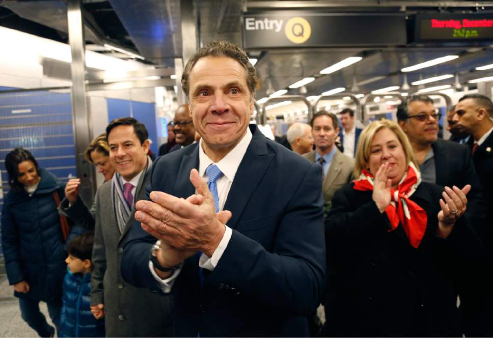 New York Governor Andrew Cuomo applauds as he greets construction workers at the new 86th Street subway station in New York, Thursday, Dec. 22, 2016. The first phase of the 2nd Avenue subway line, which has three stops, is scheduled to open on Jan. 1, 2017. (AP Photo/Seth Wenig)