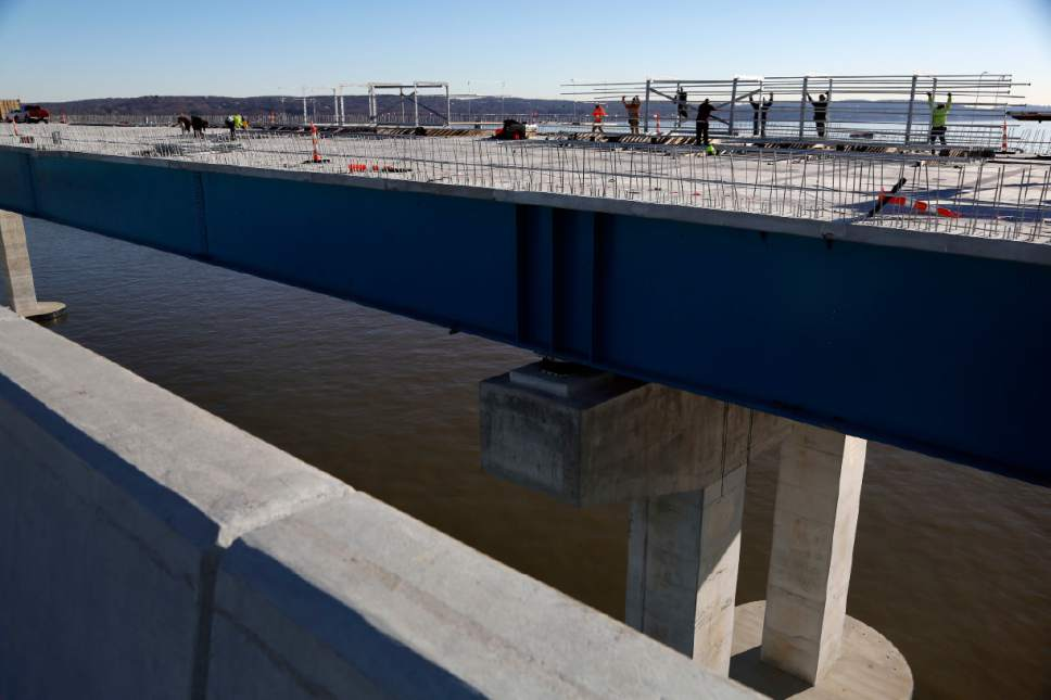 Construction continues on the new Tappan Zee Bridge near Tarrytown, N.Y., Tuesday, Dec. 20, 2016. Traffic could start rolling across the Tappan Zee as soon as the summer of 2017, but only onto one of the two separate spans linking Westchester County and Rockland County, according to Thruway Authority spokesman Khurram Saeed. It will be at least another year before it's fully open to traffic. Before the other four-lane span is completed, each end of the original bridge must be demolished to make room for land access. (AP Photo/Seth Wenig)