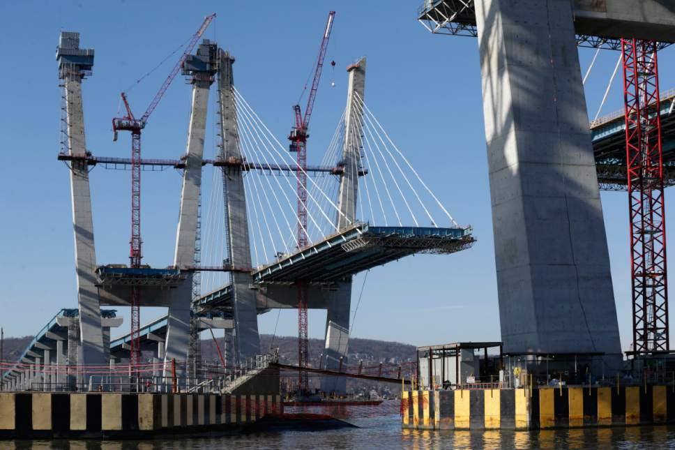 Work continues on the new Tappan Zee Bridge near Tarrytown, N.Y., Tuesday, Dec. 20, 2016. The $4 billion bridge replacement is of the biggest infrastructure efforts currently underway in the U.S. (AP Photo/Seth Wenig)