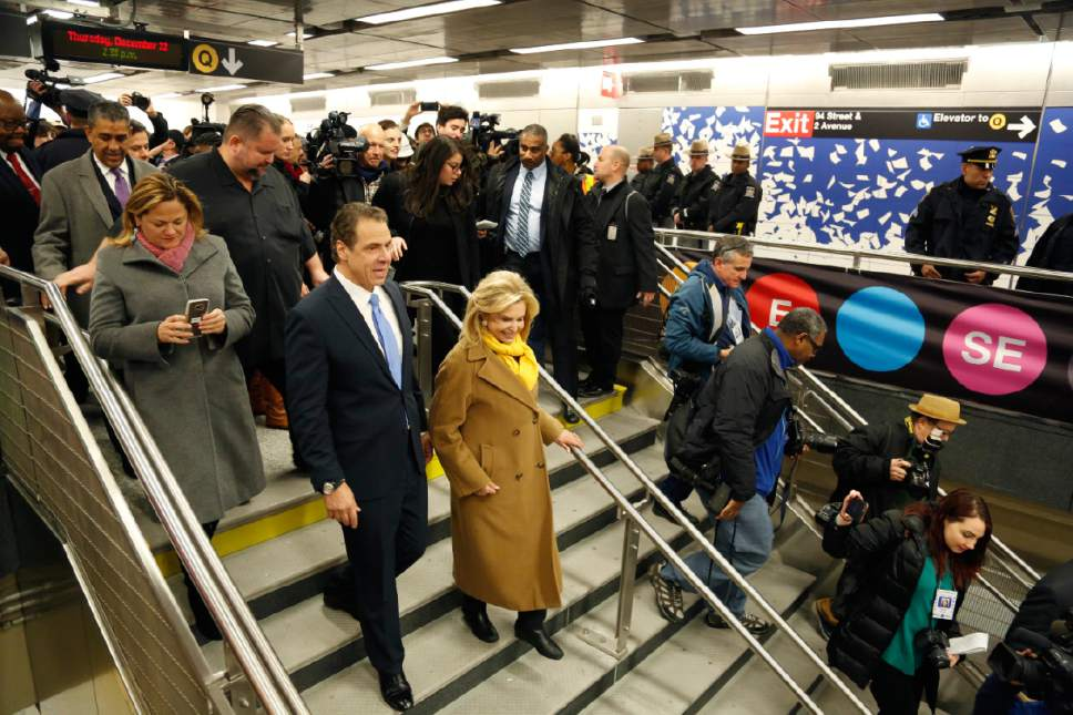 New York Gov. Andrew Cuomo, left, is surrounded by other guests and reporters as he tours the new 86th Street subway station in New York, Thursday, Dec. 22, 2016. The first phase of the 2nd Avenue subway line, which has three stops, is scheduled to open on Jan. 1, 2017. (AP Photo/Seth Wenig)