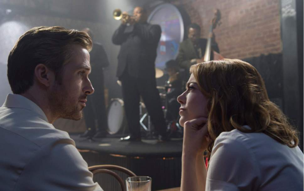 """This image released by Lionsgate shows Ryan Gosling, left, and Emma Stone in a scene from, """"La La Land."""" (Dale Robinette/Lionsgate via AP)"""