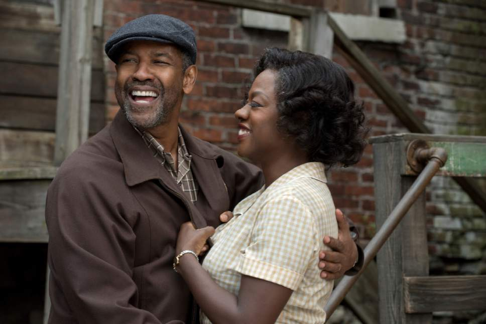 """This image released by Paramount Pictures shows Denzel Washington, left, and Viola Davis in a scene from, """"Fences."""" Washington was nominated for a Golden Globe award for best actor in a motion picture drama for his role in the film on Monday, Dec. 12, 2016. The 74th Golden Globe Awards ceremony will be broadcast on Jan. 8, on NBC.  (David Lee/Paramount Pictures via AP)"""