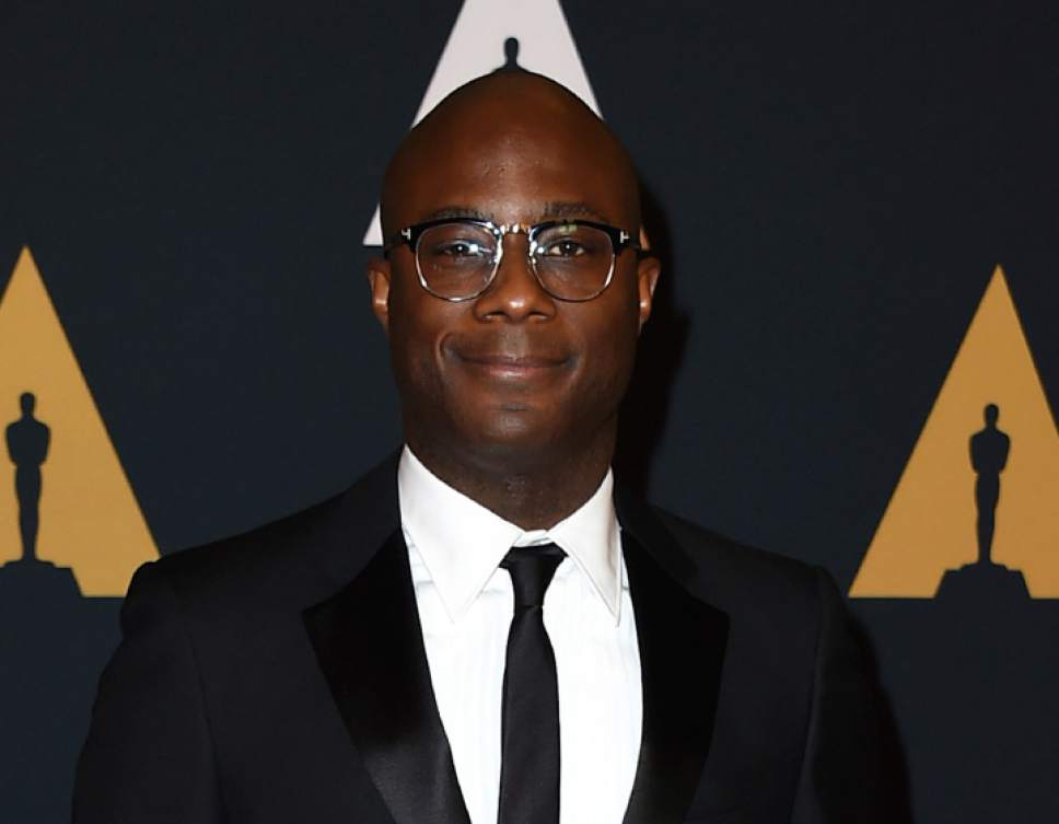 """FILE - This Nov. 12, 2016 file photo shows Barry Jenkins, director of the film, """"Moonlight,"""" at the 2016 Governors Awards in Los Angeles. Jenkins was nominated for a Golden Globe award for best director for the film on Monday, Dec. 12, 2016. The 74th Golden Globe Awards ceremony will be broadcast on Jan. 8, on NBC. (Photo by Jordan Strauss/Invision/AP, File)"""