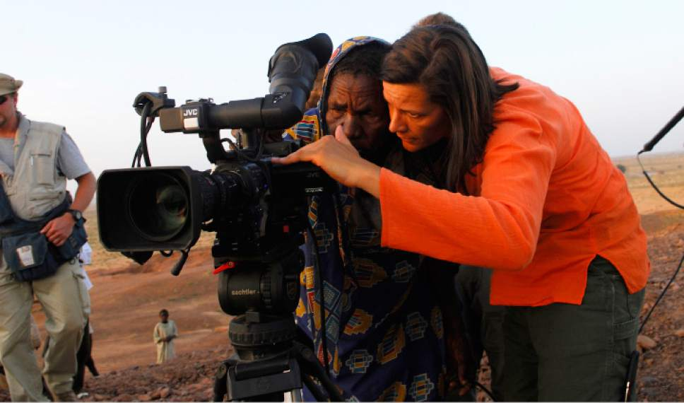 """This image released by Janus Films shows director Kirsten Johnson, right, during the filming of the documentary, """"Cameraperson."""" (Janus Films via AP)"""