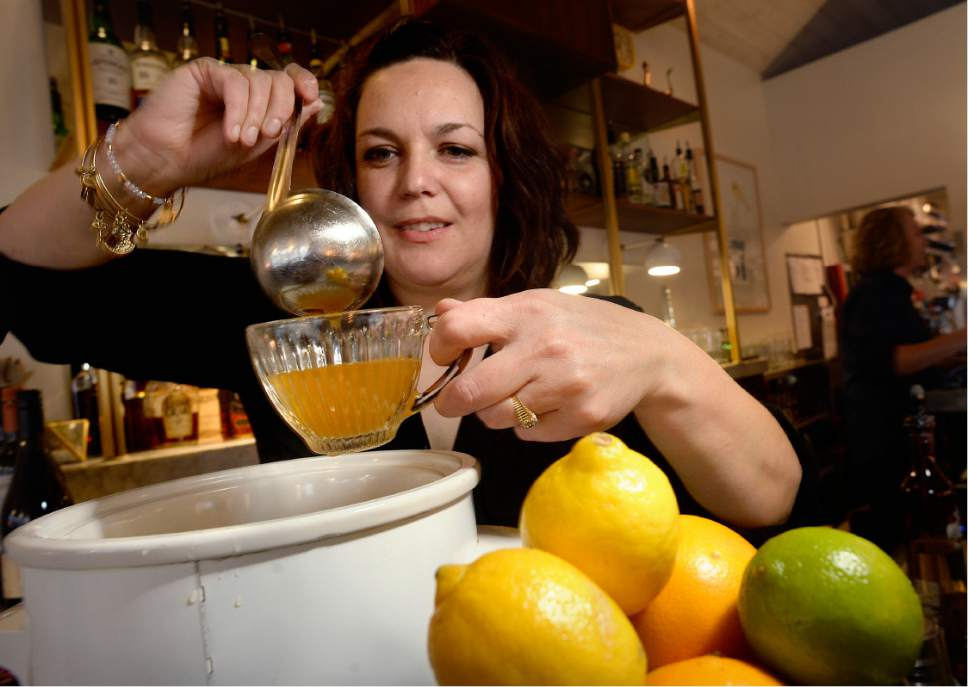 Scott Sommerdorf   |  The Salt Lake Tribune   East Liberty Tap House bartender, and cocktail creator Tracy Gomez prepares a Tequila Wassail, Friday, Dec. 16, 2016.