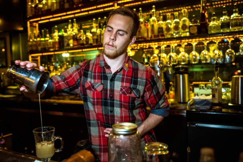 "Chris Detrick  |  The Salt Lake Tribune Bartender and cocktail creator Sam Wood makes a a ""Mersey Fog"" cocktail at Copper Common in Salt Lake City on Friday, Dec. 16, 2016.  The drink ($9) is made with Earl Grey tea, gin, agave and vanilla-flavored almond milk."