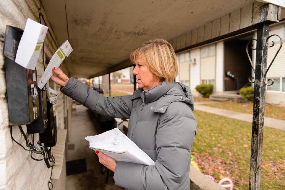 Trent Nelson  |  The Salt Lake Tribune Salt Lake City Councilwoman Lisa Adams goes door-to-door in the area around 653 E. Simpson Avenue to explain to residents what they should expect from the planned homeless shelter at that address, Wednesday December 14, 2016. She was accompanied by a police officer after receiving threatening emails.