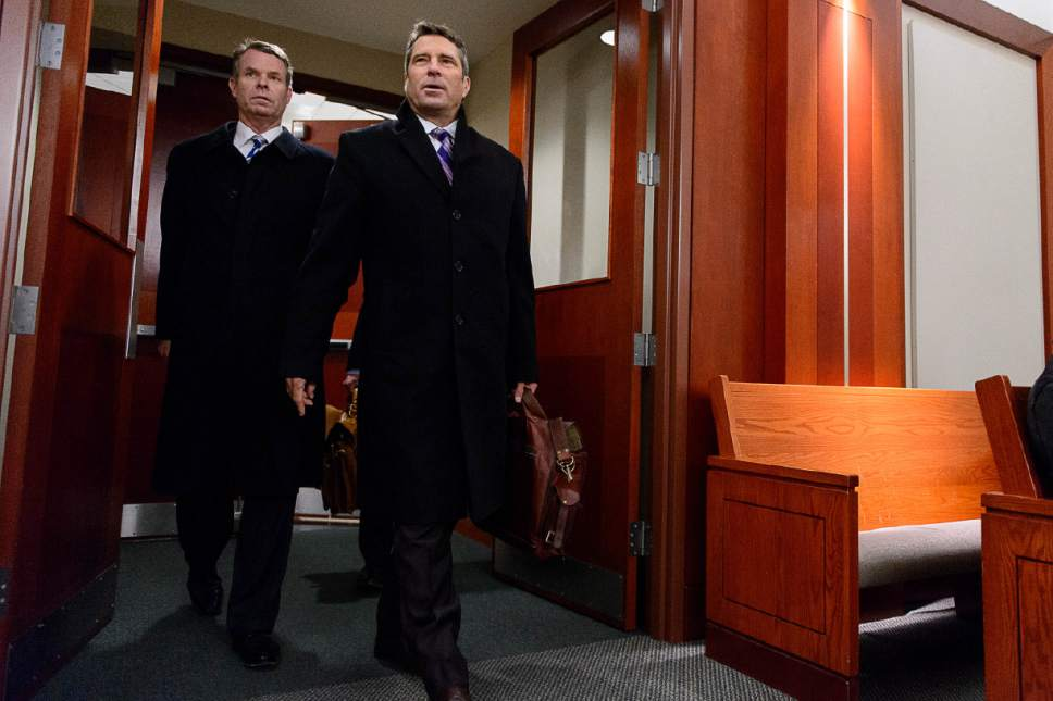 Trent Nelson  |  The Salt Lake Tribune Former Utah Attorney General John Swallow, left, charged with bribery and public corruption, arrives at a motion hearing in Salt Lake City, Friday December 9, 2016 with his attorney Scott C. Williams.