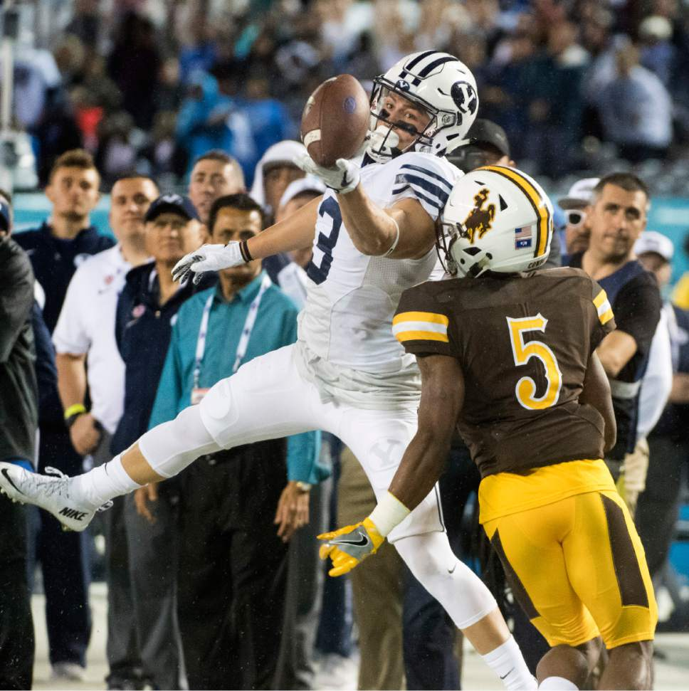 Rick Egan  |  The Salt Lake Tribune  Brigham Young Cougars wide receiver Colby Pearson (3) can't quite reach a pass, as Wyoming Cowboys cornerback Rico Gafford (5) defends, in football action, Brigham Young Cougars vs. Wyoming Cowboys at Qualcomm Stadium in San Diego, December 21, 2016.