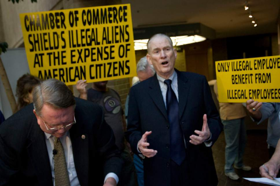 Al Hartmann  |  Tribune file photo  Late radio talk show commentator Mills Crenshaw speaks to a receptive crowd in 2011 in support of putting a measure on the 2012 ballot to penalize companies for hiring undocumented workers and to get rid of HB 116. Merrill Cook, left, signs a petition to file at the Salt Lake County Clerk's office.