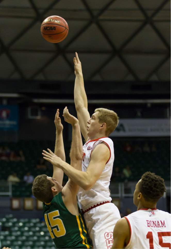 Utah forward Tyler Rawson, right, shoots over San Francisco guard Mladen Djordjevic (45) as Utah guard Lorenzo Bonam, right, looks on during the first half of an NCAA college basketball game at the Diamond Head Classic, Thursday, Dec. 22, 2016, in Honolulu. (AP Photo/Eugene Tanner)