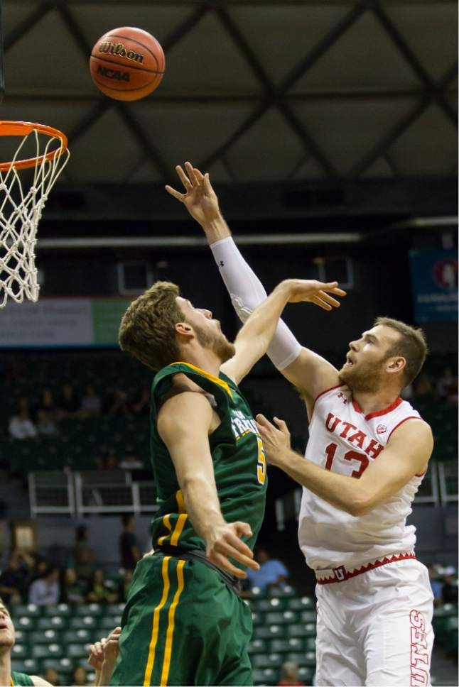 Utah forward David Collette (13) shoots over San Francisco center Jimbo Lull, left, during the first half of an NCAA college basketball game at the Diamond Head Classic, Thursday, Dec. 22, 2016, in Honolulu. (AP Photo/Eugene Tanner)