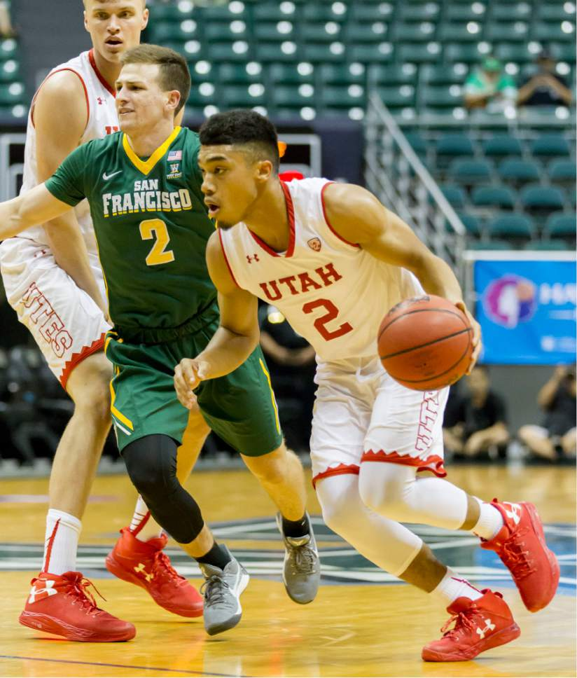 Utah guard Sedrick Barefield (2) gets past San Francisco guard Frankie Ferrari (2) during the first half of an NCAA college basketball game at the Diamond Head Classic, Thursday, Dec. 22, 2016, in Honolulu. (AP Photo/Eugene Tanner)
