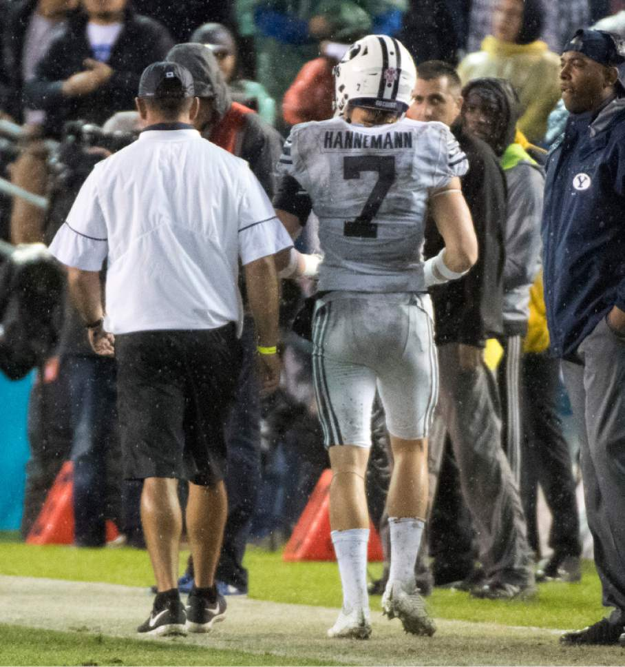 Rick Egan  |  The Salt Lake Tribune  Brigham Young Cougars defensive back Micah Hannemann (7) leaves the game after being ejected for a targeting penalty, in the Poinsettia Bowl, at Qualcomm Stadium in San Diego, December 21, 2016.