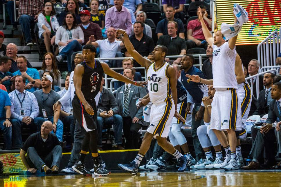 Chris Detrick  |  The Salt Lake Tribune Utah Jazz guard Alec Burks (10) makes a three pointer during the game at Vivint Smart Home Arena Friday April 8, 2016.