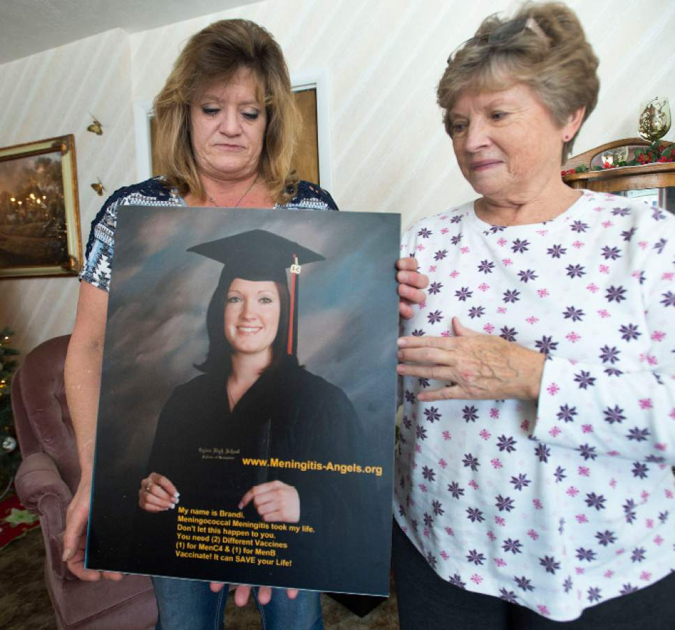 Steve Griffin / The Salt Lake Tribune   Gina Thompson, left, and her mother Janet Thompson, hold a poster of Gina's daughter, Brandi Thompson, in Janet Thompson's home in Eden, Utah Monday, Dec 5, 2016. Brandi Thompson was 21 when she got meningitis and died in 2007. Utah is one of only 12 states that don't require students to get a meningitis vaccine in college/before college.