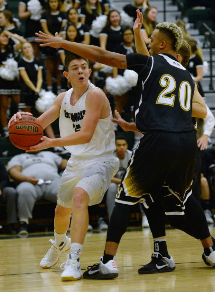 Steve Griffin / The Salt Lake Tribune  Olympus guard Rylan Jones looks to pass during game at Olympus High School in Salt Lake City Tuesday December 20, 2016.