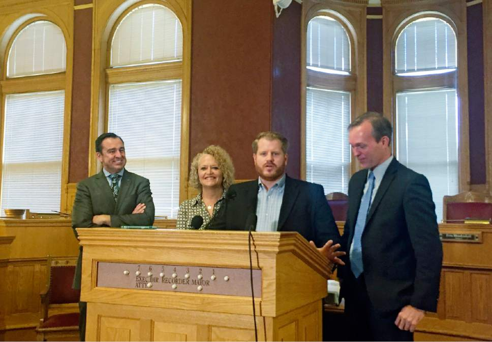 Matt Canham  |  The Salt Lake Tribune  Salt Lake City Council Chairman James Rogers speaks about a compromise on a new homeless shelter plan on Friday. He was flanked by House Speaker Greg Hughes (far left), Salt Lake City Mayor Jackie Biskupski and Salt Lake County Mayor Ben McAdams (far right).