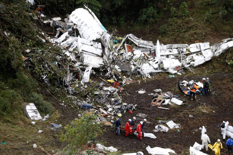 FILE - In this Nov. 29, 2016 file photo, rescue workers recover a body from the wreckage site of the LaMia chartered airplane crash, in La Union, a mountainous area near Medellin, Colombia. In a Monday, Dec. 26, 2016 statement, Colombian aviation authorities say a preliminary investigation has found that the plane that crashed just outside of Medellin with a Brazilian soccer team aboard had run out of fuel. Civil Aeronautics agency says the conclusion is based on the plane's black boxes and other evidence. (AP Photo/Fernando Vergara, File)