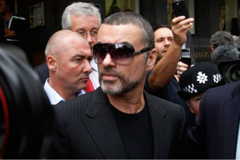 FILE - In this Aug. 24, 2010, file photo, British singer George Michael leaves Highbury Corner Magistrates Court in north London. Michael pleaded guilty in a London court to two drug offenses. He admitted driving under the influence of drugs and possession of cannabis following an incident on July 4 when his car crashed into a shop in north London. Michael, who rocketed to stardom with WHAM! and went on to enjoy a long and celebrated solo career lined with controversies, has died, his publicist said Sunday, Dec. 25, 2016. He was 53. (AP Photo/Sang Tan, File)