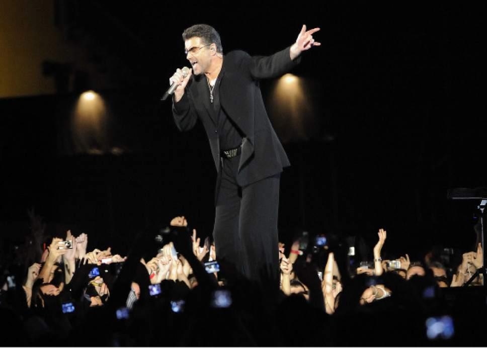 FILE - In this Monday, Dec. 1, 2008 file photo, George Michael performs at the Zayed Sports City Stadium in Abu Dhabi, United Arab Emirates, on the last stop of his 25 Live tour. Michael, who rocketed to stardom with WHAM! and went on to enjoy a long and celebrated solo career lined with controversies, has died, his publicist said Sunday, Dec. 25, 2016. He was 53. (AP Photo/Carl Abrams)