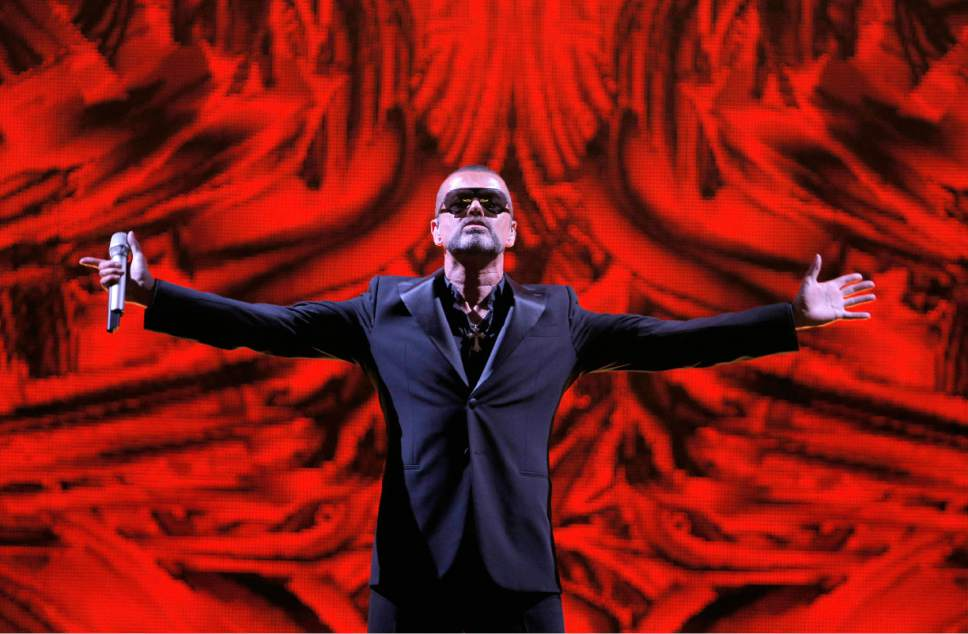 FILE - In this Sept. 9, 2012 file photo, British singer George Michael performs at a concert to raise money for the AIDS charity Sidaction, during the Symphonica tour at Palais Garnier Opera house in Paris, France. Michael, who rocketed to stardom with WHAM! and went on to enjoy a long and celebrated solo career lined with controversies, has died, his publicist said Sunday, Dec. 25, 2016. He was 53. (AP Photo/Francois Mori, File)