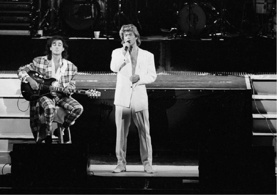 FILE - In this April 7, 1985 file photo, George Michael and Andrew Ridgeley of the British group WHAM! perform during a concert in Peking, China. Michael, who rocketed to stardom with WHAM! and went on to enjoy a long and celebrated solo career lined with controversies, has died, his publicist said Sunday, Dec. 25, 2016. He was 53. (AP Photo)
