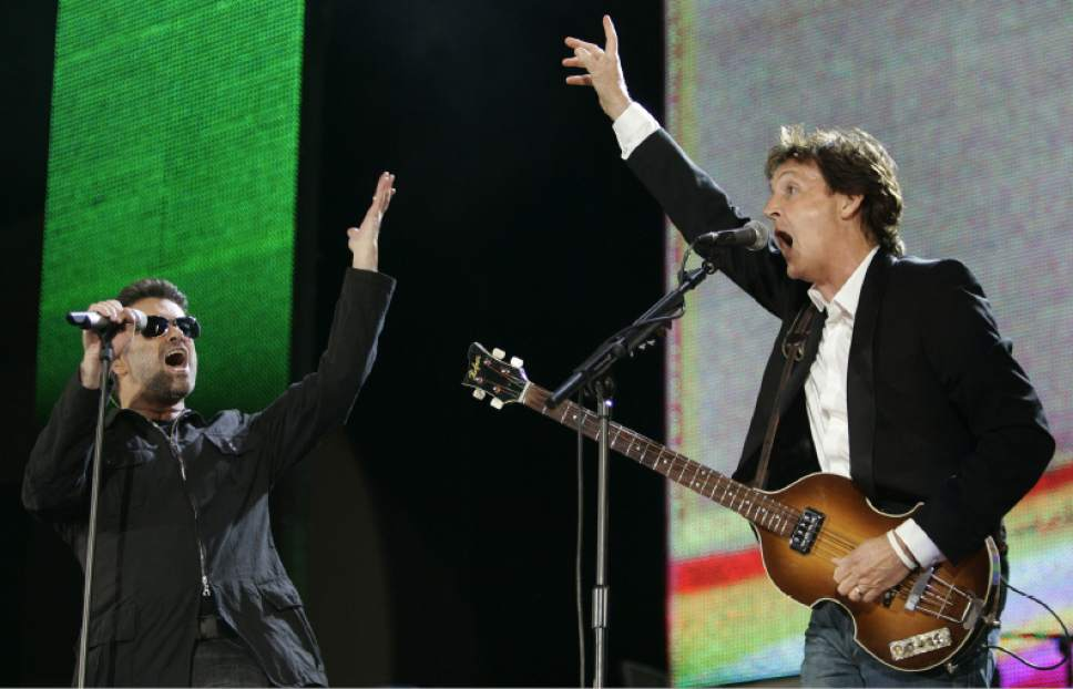 FILE - In this July 2, 2005, file photo, George Michael, left, and Paul McCartney, right, perform during the Live 8 concert in Hyde Park, London. The concert is part of a series of free concerts being held around the world designed to press leaders of the rich G8 countries to help impoverished African nations. Michael, who rocketed to stardom with WHAM! and went on to enjoy a long and celebrated solo career lined with controversies, has died, his publicist said Sunday, Dec. 25, 2016. He was 53. (AP Photo/Lefteris Pitarakis, File)