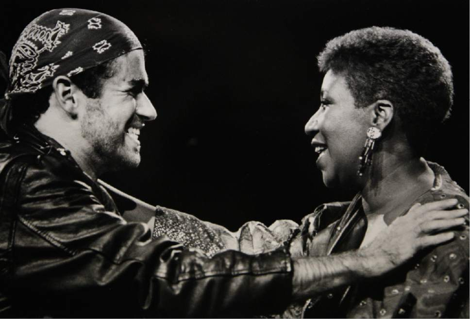 FILE - In this  Aug. 30, 1988, file photo, singing great Aretha Franklin, right, joins George Michael during his Faith World Tour in Auburn Hills, Mich. Michael, who rocketed to stardom with WHAM! and went on to enjoy a long and celebrated solo career lined with controversies, has died, his publicist said Sunday, Dec. 25, 2016. He was 53.(AP Photo/Rob Kozloff, File)