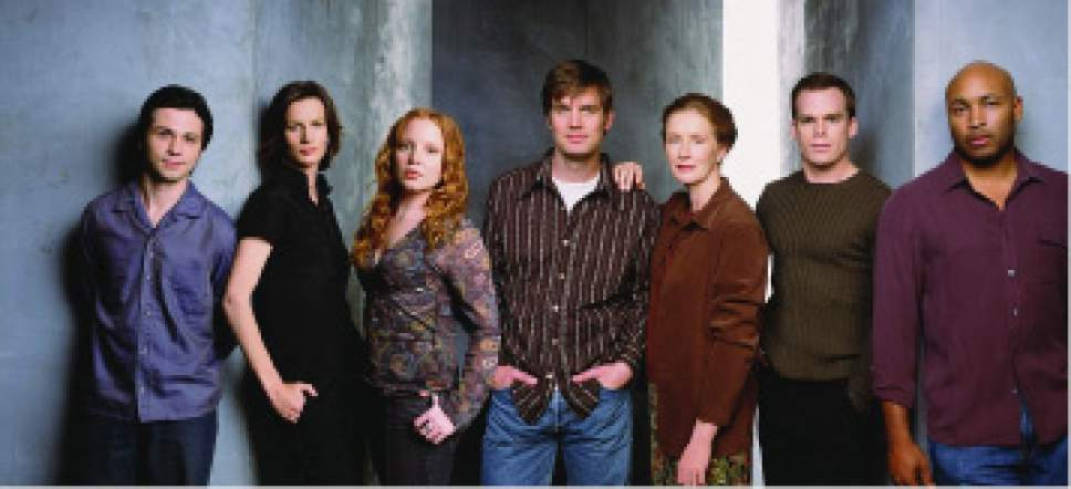 "Freddy Rodriguez, Rachel Griffiths, Lauren Ambrose, Peter Krause, Frances Conroy, Michael C. Hall and Matthew St. Patrick starred in ""Six Feet Under."" Courtesy HBO"